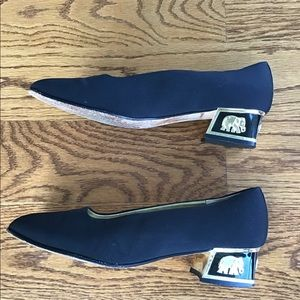 COUP D'ETAT LTD black low heels w/elephant detail
